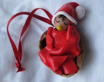 Baby Santa in Walnut Cradle, Christmas decoration, handmade ornament, Xmas tree decoration, fimo figurine, McFaerie
