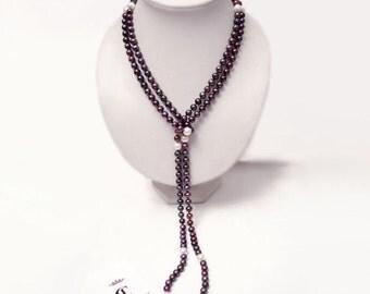 Pearl necklace - a tie
