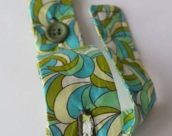 Handgel holder - blue, green white.
