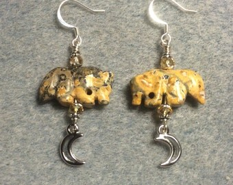 Picture jasper gemstone wolf fetish bead earrings adorned with silver crescent moon charms and tan crystal beads.