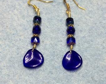 Cobalt blue Czech glass rose petal dangle earrings adorned with cobalt blue Czech glass beads.