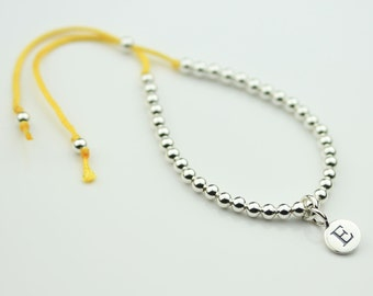 Children's Silver Bead and Cotton Thread Friendship Bracelet Personalised with a Solid Silver Stamped Initial Charm