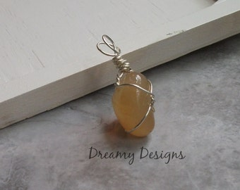 Peach Stone - Wire Wrapped Polished Stone Pendant
