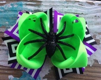 Halloween hair bow topped with a glittery spider!