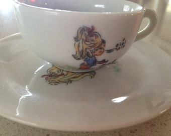 Delightful  Little Girl watering her flowers cup and saucer set