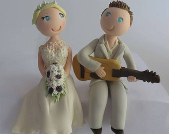 Customised Cake topper with groom playing guitar
