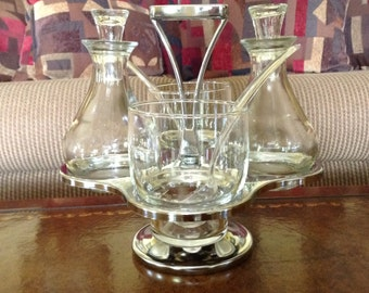 Mid-Century Modern Stainless Steel and Wood Condiment Carousel With Glass Cups and Cruets