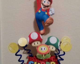 Super Mario Centerpieces. This listing is for ONLY 2 of the 4 I have in the picture.