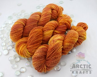 Camp Fire, hand dyed, chunky weight thick and thin yarn. 140 yards