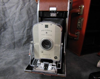 Polaroid  Model 95 Land Camera, with Filter Kit, Light Meter and Photo Coater Sticks