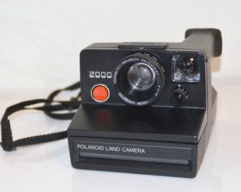 camera Polaroid 2000 black, red button, camera,