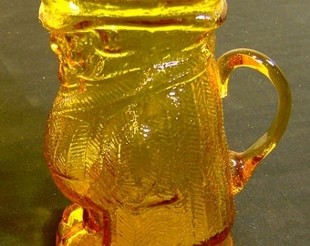Toby pitcher, amber glass