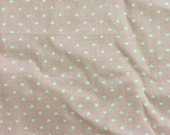 pink fabric with tiny white hearts