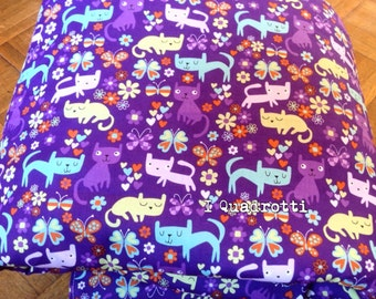 Purple quilt with cats