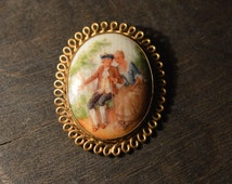 Vintage hand painted porcelain brooch 1930 witl love theme / rococo style