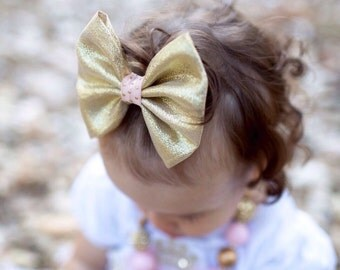 Gold bow hair clip; Gold fabric bow with a peach polka dot center on alligator hair clip; gold birthday party bow; baby, toddler, or girl