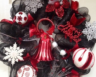 Black, red and white Christmas wreath