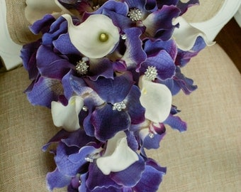 Modern purple and ivory tear drop wedding bouquet. Made with artificial orchids and calla lilies.
