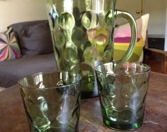 Six green Hazel Atlas bubble glasses and one pitcher