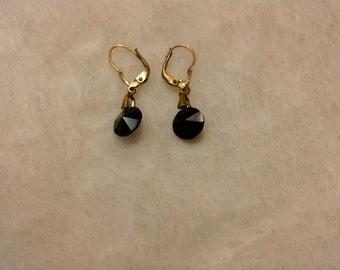Black circle diamond cut earrings