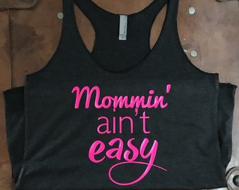 Mommin' ain't easy- Premium Triblend Racerback relaxed-fit tank - In black, grey, navy with neon pink vinyl graphic - S-XL