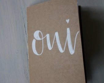 "Kraft Journal ""oui"" in brush lettering 40 pages"