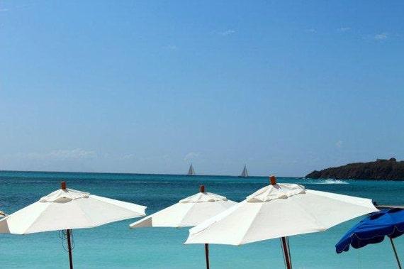 Reflective Caribbean: White Reflective Beach UmbrellaSailing Boats On Horizon