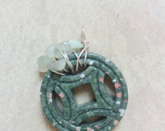 Asymmetrical green stone with jade chips