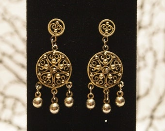 fashionable Gold tone dangling earrings