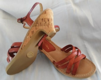 Deep tan sandal. All leather strappy uppers with leather padded insole.1 1/2 in. cork heel with man made sole. Never worn-Sz 8