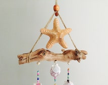 Sun catcher,crystals,wind chime,star fish,seashells,mystical