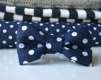 Blue bow bracelet with white polka dots