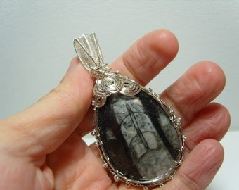 Beautiful Orthoceras fossil knitted silver plated wire pendant
