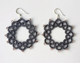 Circular lace earrings with beads made of needle tatting technique