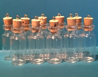 18 Small glass vial with cork and eyelet ring