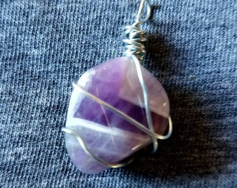 Wire wrapped polished Amethyst stone pendant