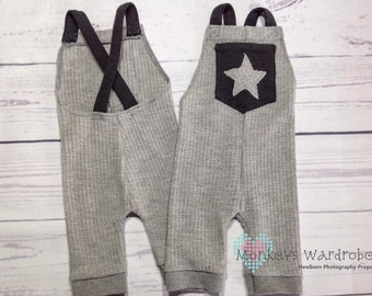 Newborn boy 'Jackson' grey romper with star pocket detail.