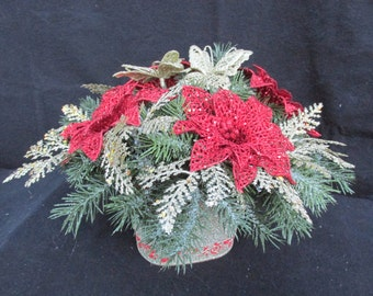 Red Poinsettias and Champagne Butterflies:  Christmas Floral/Oval Champagne Pot/ Frosted Evergreens  / Red Glitter Points/Champagne Picks