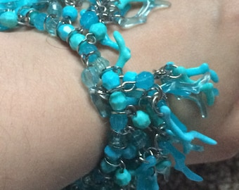 Vintage never been used turquoise colored costume coral bracelet