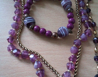 collection of purple bead jewellery