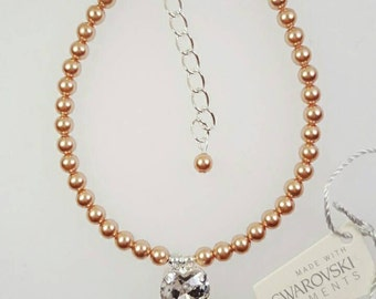 Rose gold Swarovski crystal heart charm bracelet.