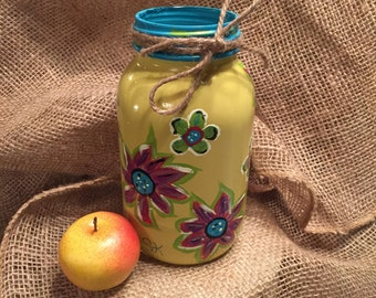Hand painted whimsical mason jar.