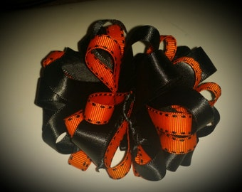 Black and orange loopy bow