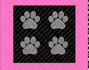 Set of 4, 2 5/8 inch solid paw print rhinestone appliqués.