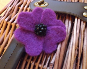 Hand needle felted brooch, purple and black with bead embellishment