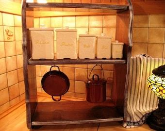 Antique shelf with spice jars & enamel pans