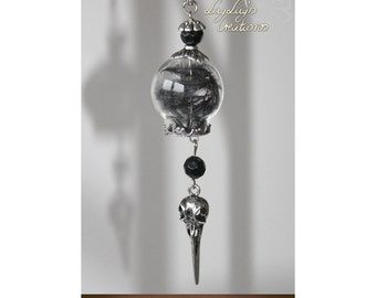 Glass with black feathers and bird skull (chain)