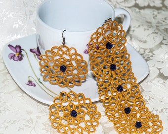 Co-ordinated bracelets and earrings made with mustard and dark blue pink tatting