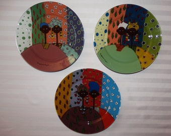 Lot of three dinner plates painted by hand - African designs