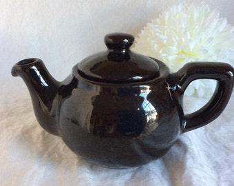 Vintage black ceramic teapot.